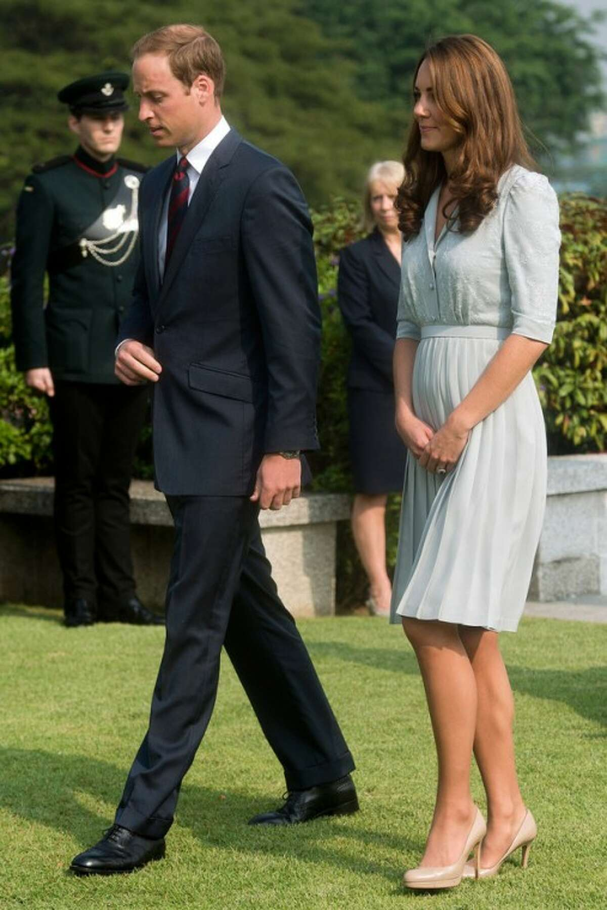 FILE - In this Thursday, Sept. 13, 2012 file photo, Britain's Prince William and his wife Kate, the Duke and Duchess of Cambridge, walk together as they visit the Kranji Commonwealth War Memorial in Singapore. Prince William and his wife Catherine are expecting their first child. St. James?'s Palace announced the pregnancy Monday, saying that the Duchess of Cambridge, formerly known as Kate Middleton has a severe form of morning sickness and is currently in a London hospital. William is at his wife?'s side. (AP Photo/Nicolas Asfouri, Pool, File)