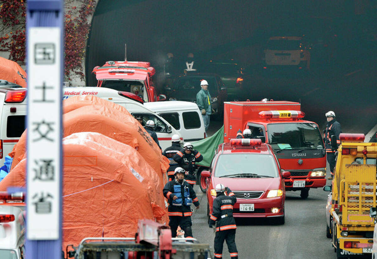Ap photo Firefighters work at the exit of the Sasago Tunnel on the Chuo Expressway in Otsuki, Yamanashi Prefecture, central Japan, Monday morning, Dec. 3.