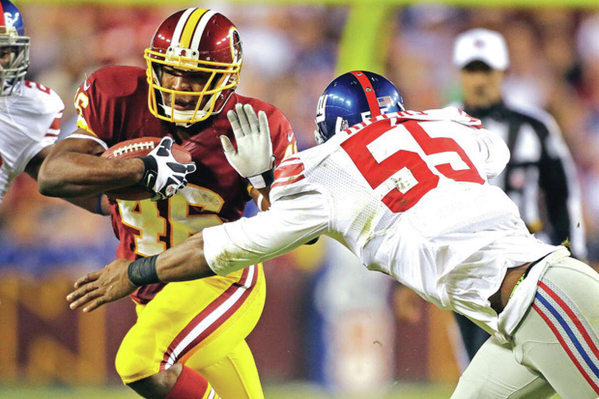 AP photo New York Giants outside linebacker Keith Rivers (55) tries to bring down Washington Redskins running back Alfred Morris during Monday night's game. Morris and Robert Griffin III ran wild against the Giants, whose run defense has been shaky at best throughout the season. Next up is New Orleans, with its four-headed running game.
