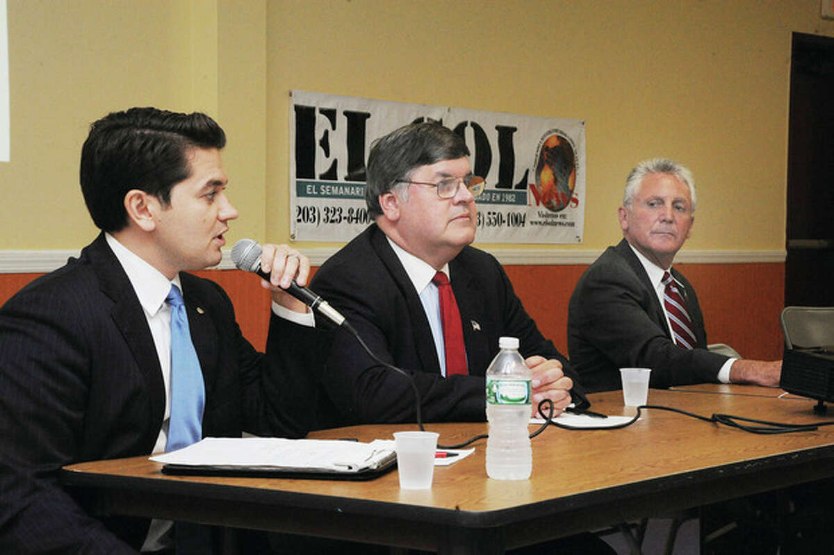 Hour photo/Matthew Vinci District D Chairman Vinny Mangiacopra, Councilman Matt Miklave and former Police Chief Harry Rilling participate in a Mayoral Debate Forum at the South Norwalk Community Center on Tuesday night, taking questions and concerns from the Latino community. Candidate Andy Garfunkel was unable to attend.
