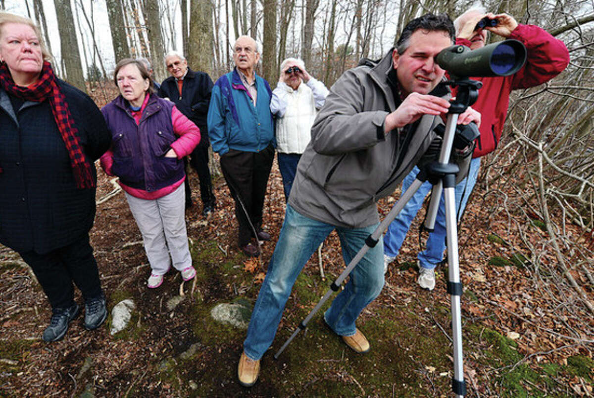 Hour newspapers editor Chris Bosak tlk about his experience as a bird watcher during a discussion and field trip at the Norwalk Senior Center. Hour photo / Erik Trautmann