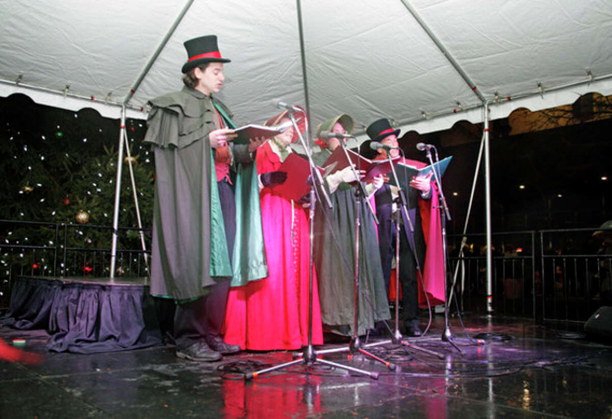 Crystal Theatre carolers sing holiday music upon Santa's arrival at Norwalk City Hall's Holiday Tree Lighting Ceremony at 50 Washington Street in Norwalk Friday evening. Hour Photo / Danielle Robinson