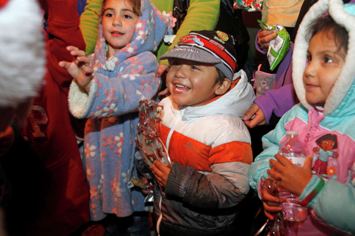 Daniel Trejo, 4, smiles as he recieves a bag of goodies from Santa at Norwalk City Hall's Holiday Tree Lighting Ceremony at 50 Washington Street in Norwalk Friday evening. Hour Photo / Danielle Robinson