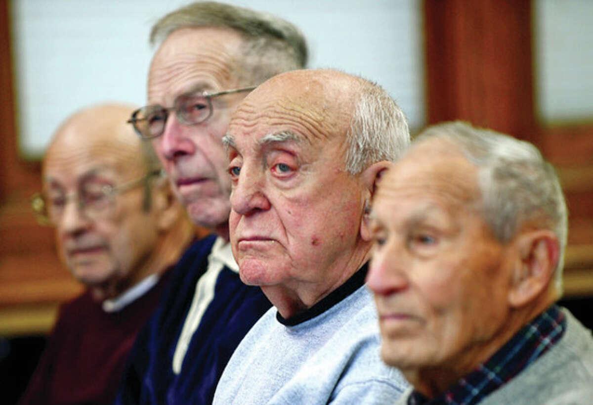Seniors listen to military historian Mark Albert as he gives a presentation, Pearl Harbor, at the Norwalk Senior Center Thursday mornring. Hour photo / Erik Trautmann