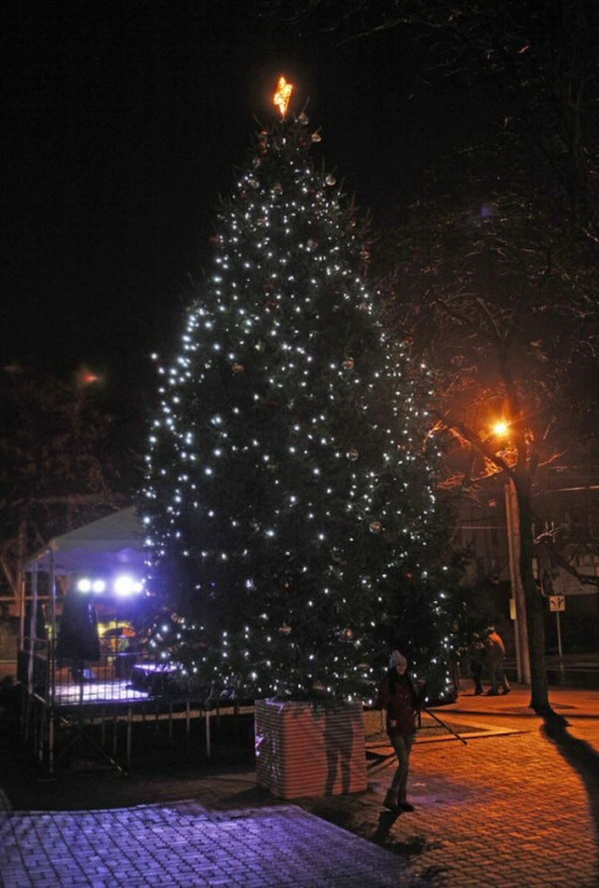 SoNo tree lights up Above, a woman poses in front of Norwalk City Hall's holiday tree during the annual