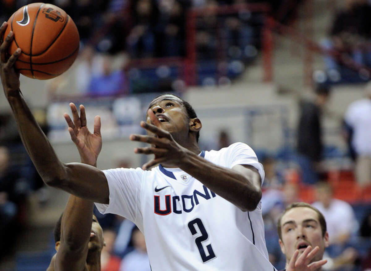 Connecticut's DeAndre Daniels goes to the basket during the first half of an NCAA college basketball game against Harvard in Storrs, Conn., Friday, Dec. 7, 2012. (AP Photo/Fred Beckham)