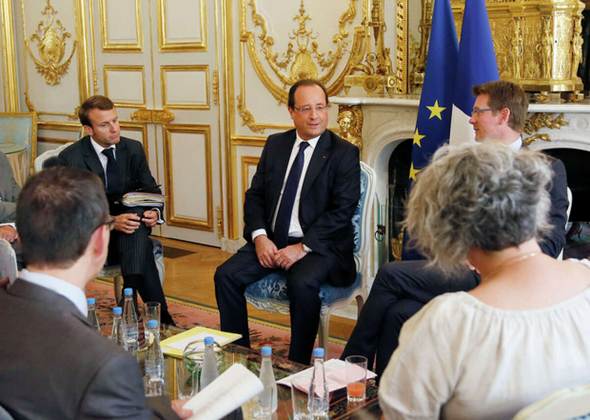 French President Francois Hollande, center, speaks to representatives of non-governmental organizations (NGO) in preparation for the upcoming G20 summit in Saint Petersburg, during a meeting at the Elysee Palace in Paris, Friday Aug. 30, 2013. If France and the United States are ever going to move beyond French opposition to the Iraq War, this could be the time. President Barack Obama and Hollande spoke by phone Friday about Syria, and