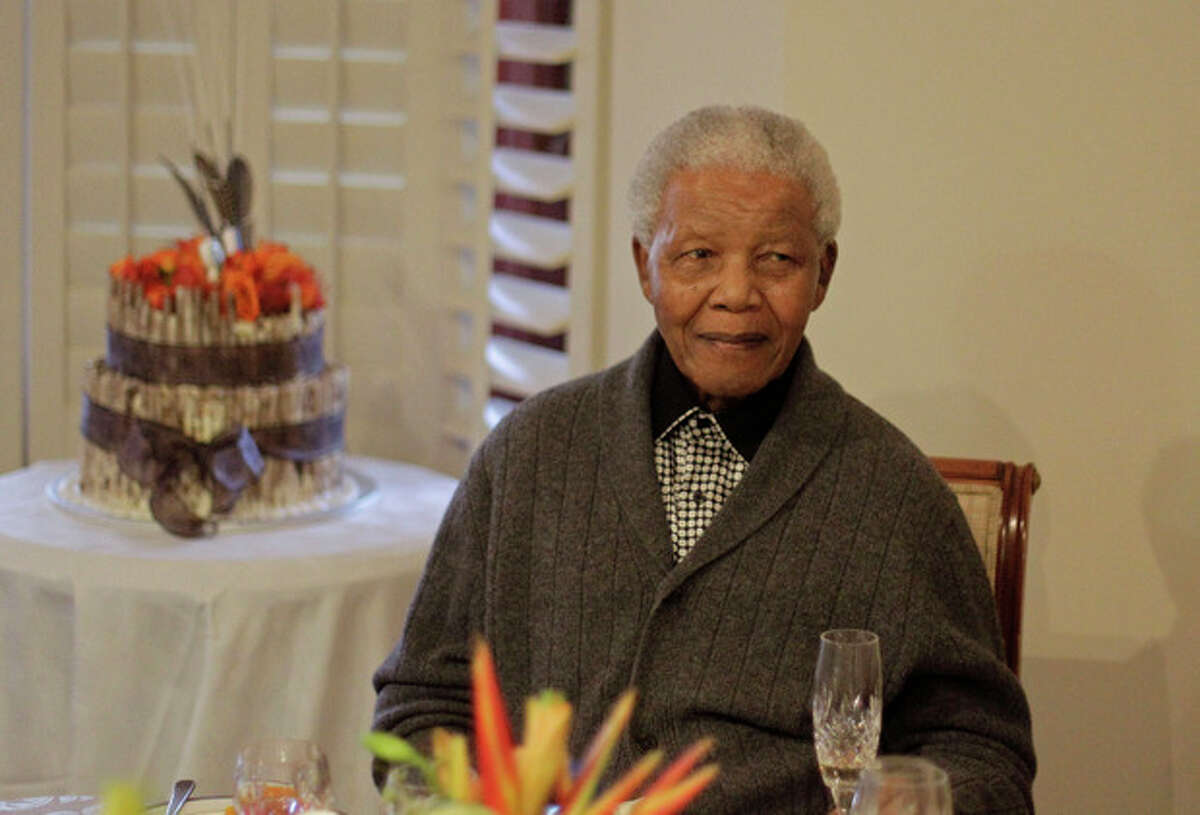 FILE - In this Wednesday, July 18, 2012 file photo, former South African President Nelson Mandela as he celebrates his birthday with family in Qunu, South Africa. South African President Jacob Zuma says that former President Nelson Mandela has been admitted to hospital in Pretoria to undergo tests. Zuma issued a statement Saturday, Dec. 8, 2012 saying that Mandela is