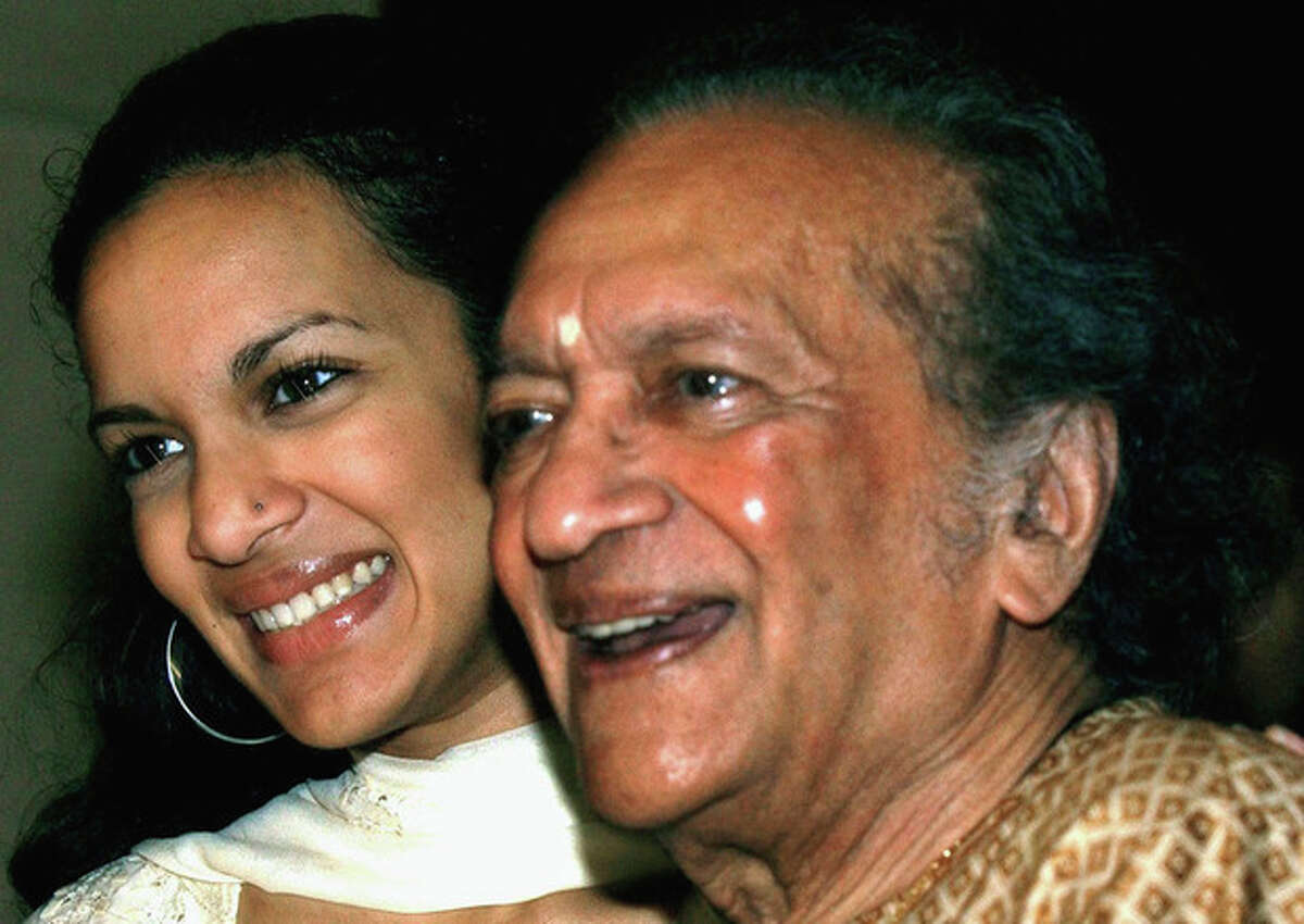 FILE - In this Dec. 19, 2002, Indian Sitar maestro Ravi Shankar, right, and daughter Anoushka Shankar smile during a press conference in Calcutta, India. Shankar, the sitar virtuoso who became a hippie musical icon of the 1960s after hobnobbing with the Beatles and who introduced traditional Indian ragas to Western audiences over an eight-decade career, has died. He was 92. (AP Photo/Bikas Das, File)
