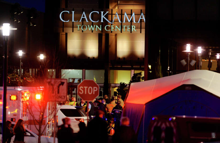 Police and medics work the scene of a multiple shooting at Clackamas Town Center Mall in Portland, Ore., Tuesday Dec. 11, 2012. A gunman is dead after opening fire in the Portland, Ore., area shopping mall Tuesday, killing two people and wounding another, sheriff's deputies said. (AP Photo/Greg Wahl-Stephens) / FR29287 AP