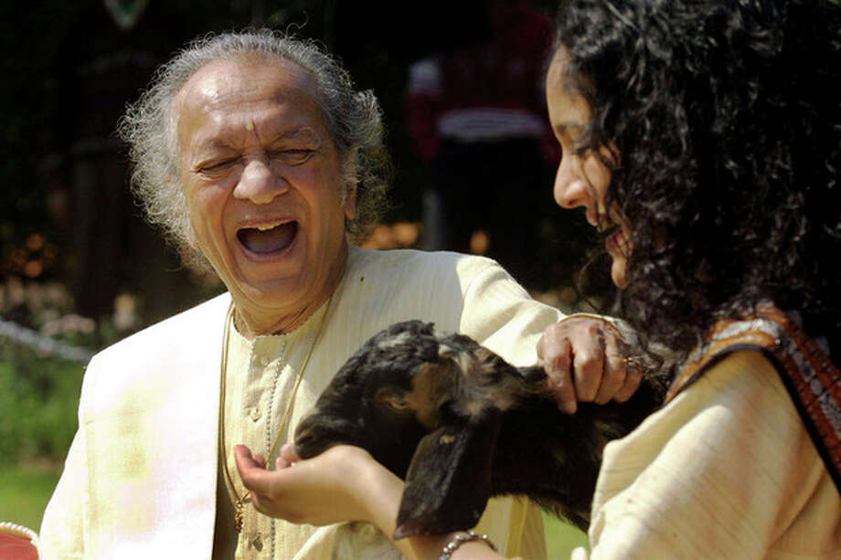 FILE - In this Feb. 25, 2002 file photo, Sitar maestro Pandit Ravi Shankar, left, and his daughter Anoushka Shankar laugh during the shooting of a film endorsing the strengthening of Indian laws against animal cruelty in New Delhi. Shankar, the sitar virtuoso who became a hippie musical icon of the 1960s after hobnobbing with the Beatles and who introduced traditional Indian ragas to Western audiences over an eight-decade career, died Tuesday, Dec. 11, 2012. He was 92. (AP photo/Gurinder Osan, File) / AP