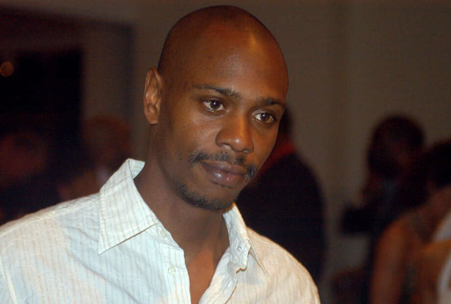 Inb a May 5, 2006 file photo comedian Dave Chappelle attends a reception at the Muhammad Ali Center in Louisville, Ky. Chappelle decided to sit out most of his show in Hartford Thursday, Aiug. 29, 2013, because of a noisy audience. (AP Photo/Brian Bohannon, file) / AP