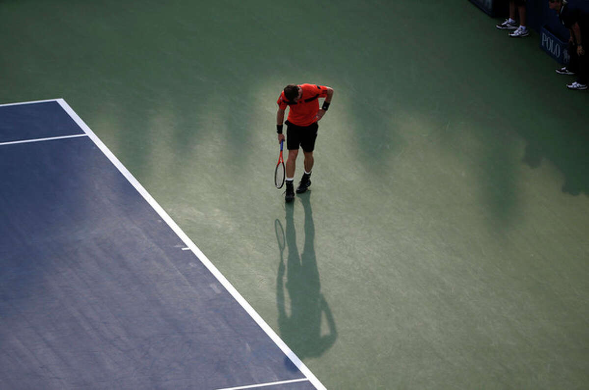Andy Murray reacts after a lost point against Leonardo Mayer of Argentina during the second round of the 2013 U.S. Open tennis tournament, Friday, Aug. 30, 2013, in New York. (AP Photo/David Goldman)