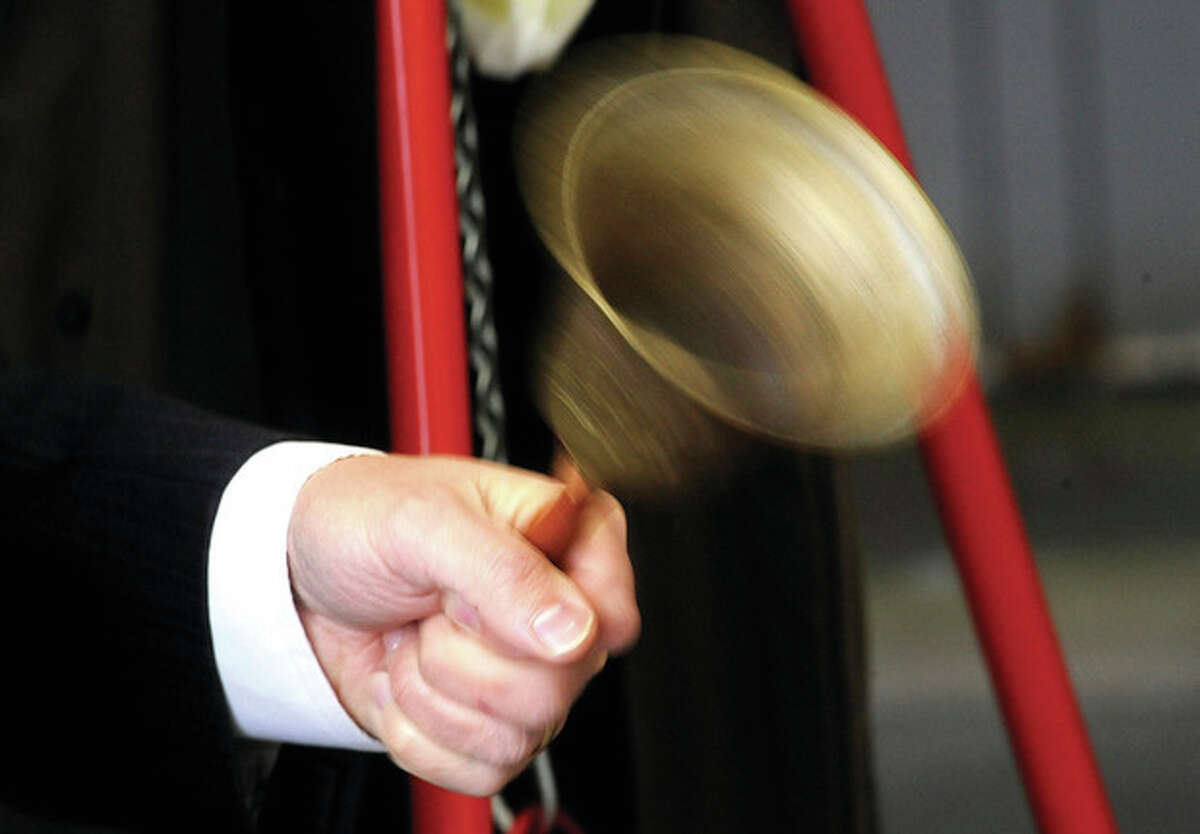 State Senator Bob Duff volunteers Monday to ring the bell beside the Salvation Army red kettle at the main avenue location of Walmart. hour photo/Matthew Vinci