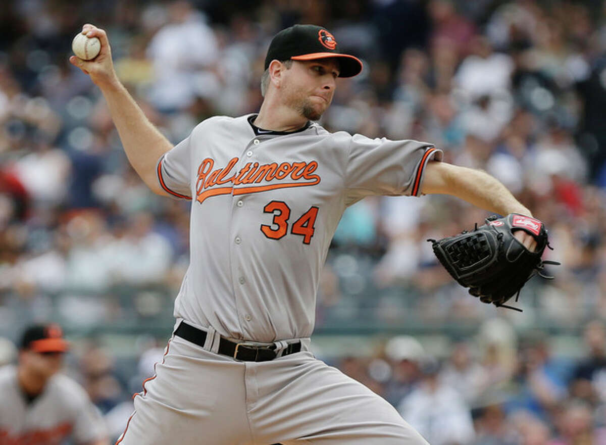 Baltimore Orioles' Scott Feldman delivers a pitch during the first inning of a baseball game against the New York Yankees Saturday, Aug. 31, 2013, in New York.The (AP Photo/Frank Franklin II)