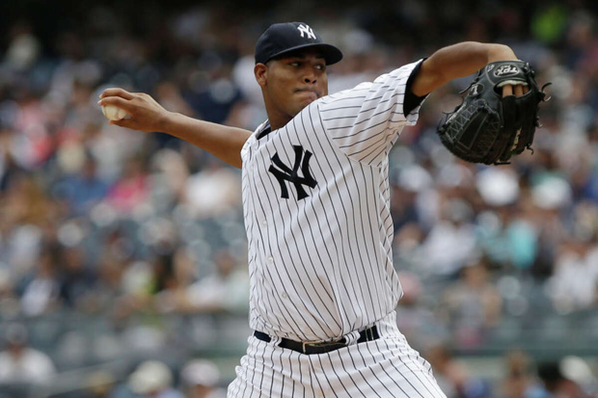 New York Yankees' Ivan Nova delivers a pitch during the first inning of a baseball game against the Baltimore Orioles Saturday, Aug. 31, 2013, in New York.The (AP Photo/Frank Franklin II)
