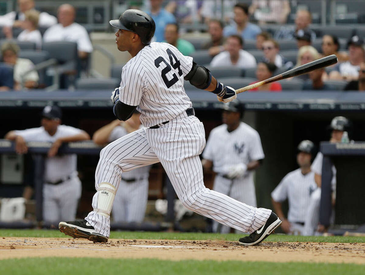 New York Yankees' Robinson Cano follows through with an RBI double during the first inning of a baseball game against the Baltimore Orioles Saturday, Aug. 31, 2013, in New York.The (AP Photo/Frank Franklin II)