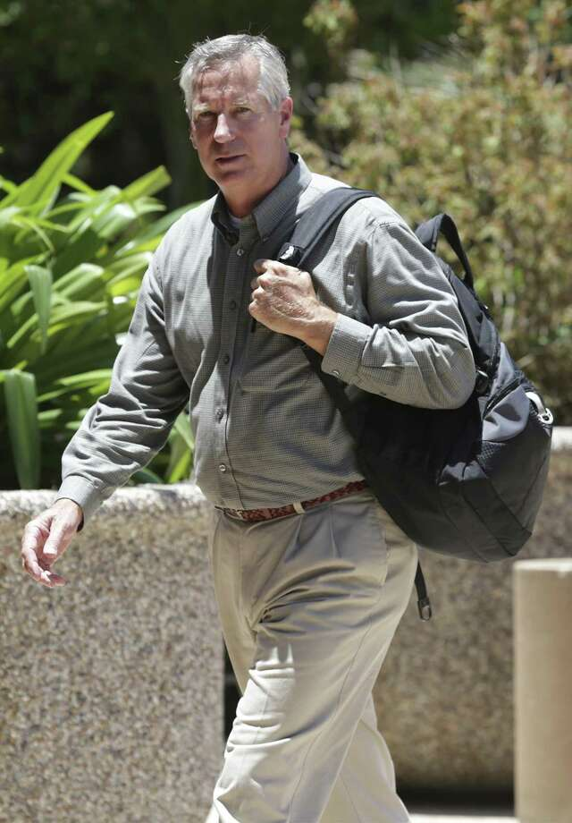 Former United Airlines pilot Mark Joseph Uhlenbrock walks in to the San Antonio federal courthouse to enter a guilty plea to stalking in a 2016 criminal case. He was sentenced to 41 months in federal prison. He is scheduled to be released in October. Photo: Tom Reel /Staff Photographer / 2016 SAN ANTONIO EXPRESS-NEWS