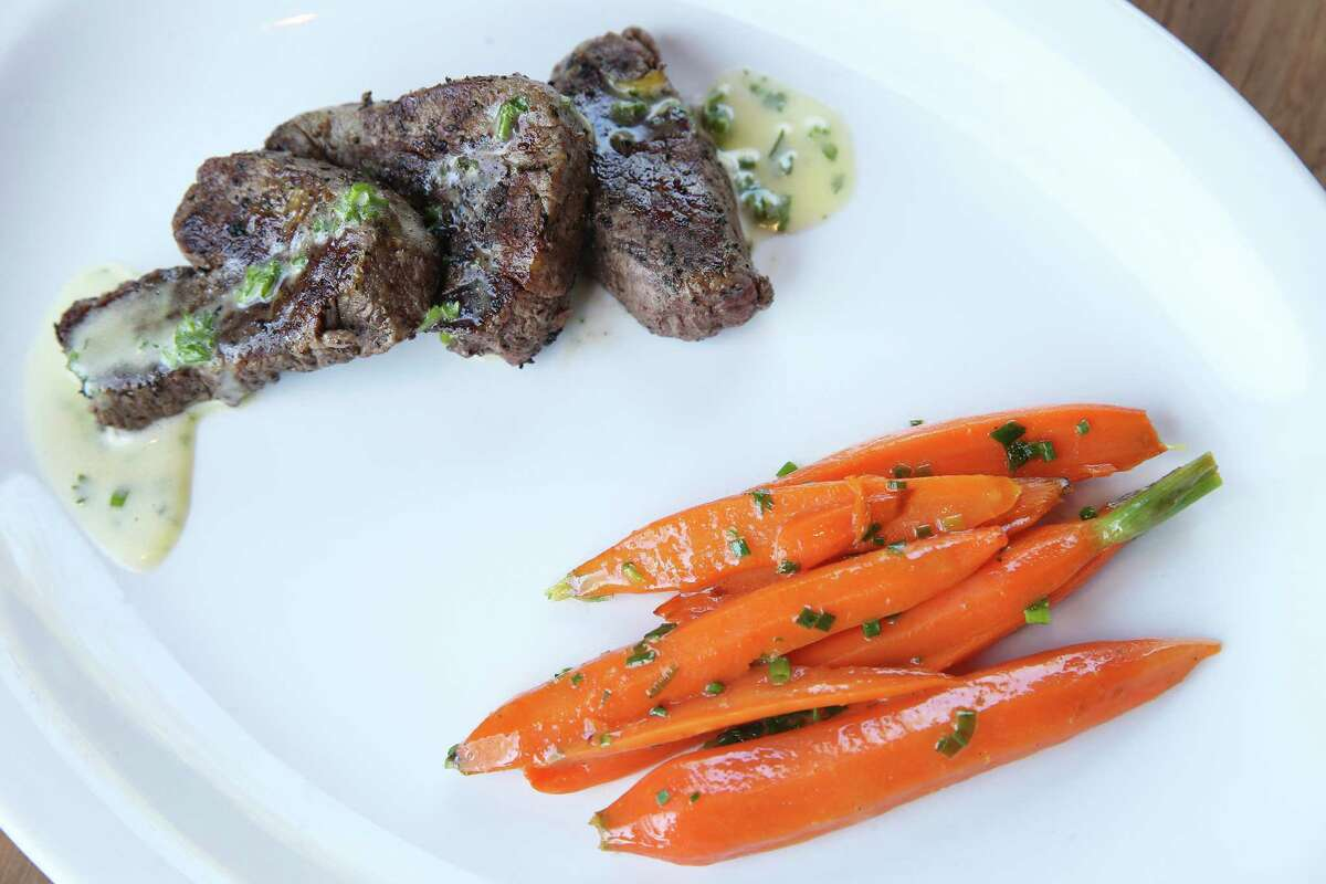 Beef tenderloin medallions are covered in a lemon-butter sauce and usually served with fries.