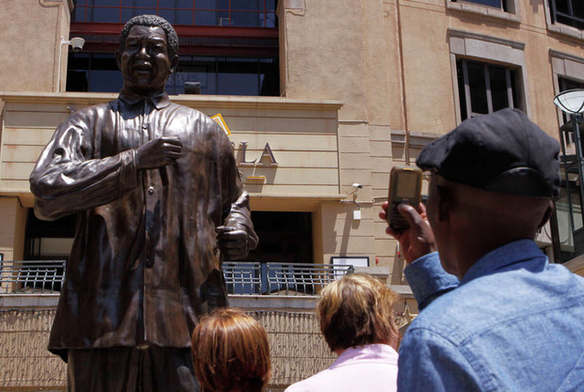 Ap photo People take photos of the giant statue of former president Nelson Mandela, in Mandela Square, Johannesburg, South Africa, Sunday Dec. 9.
