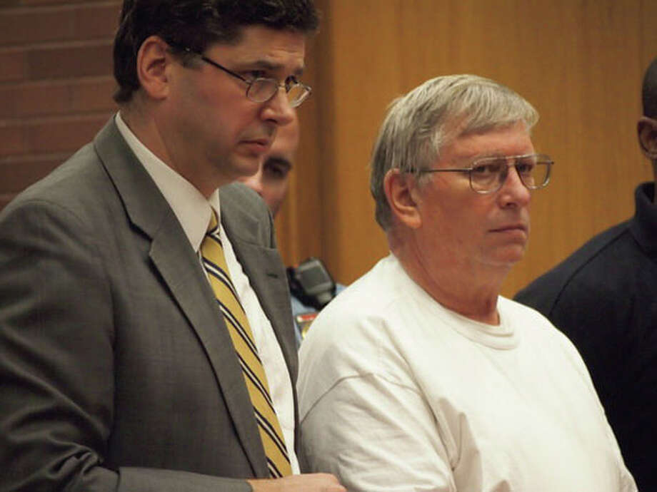 Robert Bell, 63, of New Fairfield, appears before Judge John Blawie in Danbury Superior Court on Monday, Dec. 10 for his arraignment on a charge of first-degree manslaughter. Bell is accused of shooting and killing his wife, Svetlana, Bell, 47, and is being represented by Public Defender Mark Johnson, left.
