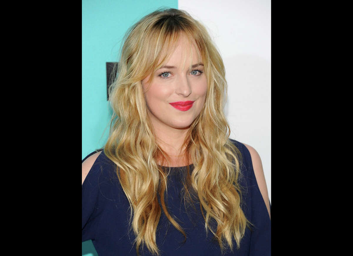 FILE - Dakota Johnson attends the FOX network upfront presentation party at Wollman Rink, in New York in a May 14, 2012 file photo. Focus Features and Universal Pictures announced Monday, Sept. 2, 2013 that Dakota Johnson will play Anastasia Steele in the big-screen adaptation of E L James?' ?
