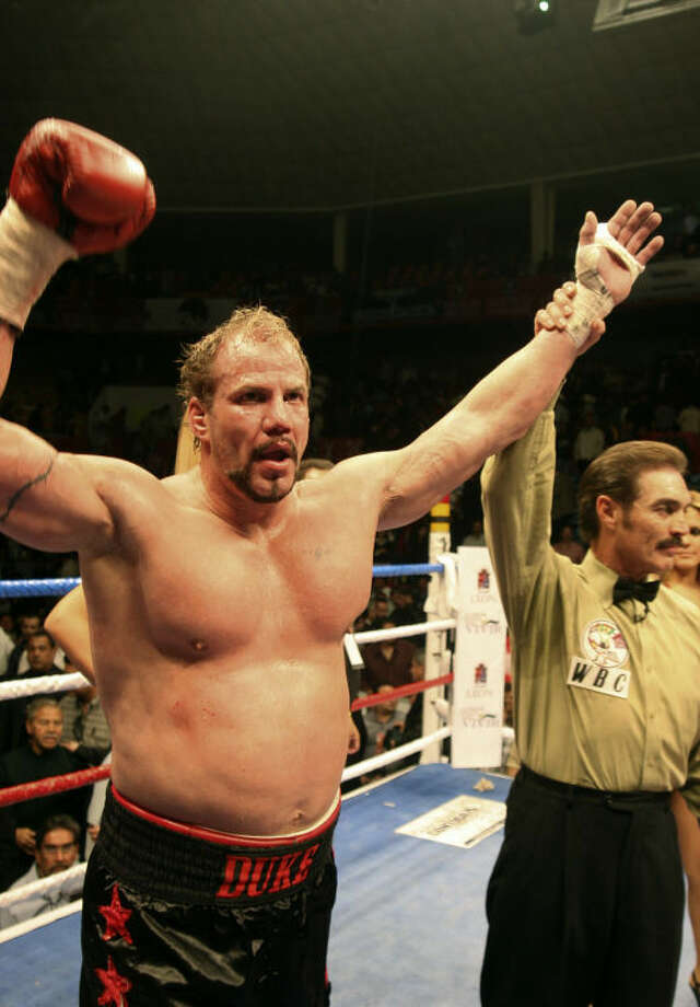 """FILEm- In this Feb. 9, 2008 file photo, former world heavyweight champion Tommy Morrison, celebates after defeating Matt Weishaar in Leon, Mexico. Morrison, who gained fame for his role in the movie """"Rocky V,"""" has died. He was 44. Morrison's former manager, Tony Holden says his longtime friend died Sunday night, Sept. 1, 2013, at a Nebraska hospital. (AP Photo/Mario Armas)"""