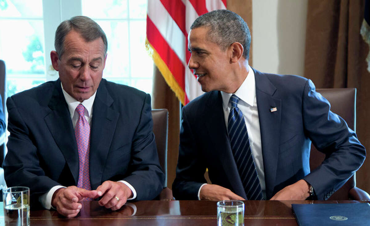 President Barack Obama talks with House Speaker John Boehner of Ohio, prior to speaking to media, in the Cabinet Room of the White House in Washington, Tuesday, Sept. 3, 2013, before a meeting with members of Congress to discuss the situation in Syria. (AP Photo/Carolyn Kaster)