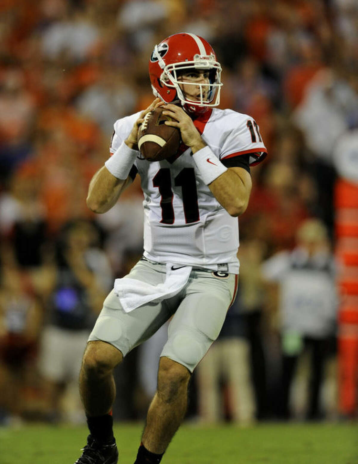 Georgia quarterback Aaron Murray drops back to pass during the first half of an NCAA college football game against Clemson at Memorial Stadium, Saturday, Aug. 31, 2013, in Clemson, S.C. (AP Photo/Richard Shiro)