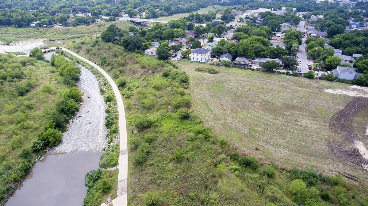 The site of Confluence Park is seen from above earlier this year. The park will be located on the mowed field shown on the right. H-E-B is giving a $1 million gift to the San Antonio River Foundation to help construct the park, which will open later this year.