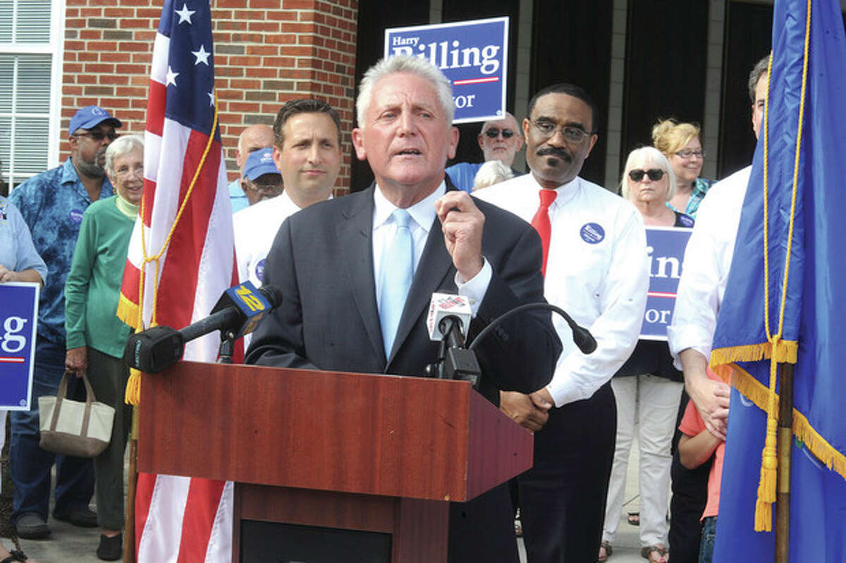 Hour photo/Matthew Vinci Former Norwalk Police Chief Harry Rilling announces support from State Sen. Bob Duff, State Reps. Bruce Morris and Chris Perone Tuesday at Norwalk City Hall.