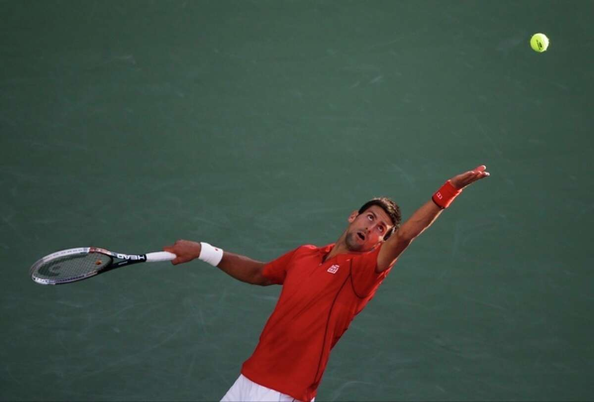 Novak Djokovic, of Serbia, serves against Marcel Granollers, of Spain, during the fourth round of the 2013 U.S. Open tennis tournament, Tuesday, Sept. 3, 2013, in New York. (AP Photo/Charles Krupa)