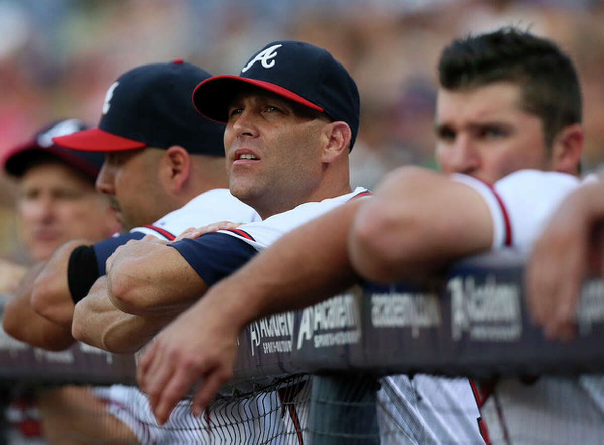 Injured Atlanta Braves pitcher Tim Hudson, center, watches from the dugout railing during the first inning against a baseball game against the New York Mets Tuesday, Sept. 3, 2013, in Atlanta. (AP Photo/Atlanta Journal-Constitution, Curtis Compton) MARIETTA DAILY OUT; GWINNETT DAILY POST OUT; LOCAL TV OUT; WXIA-TV OUT; WGCL-TV OUT