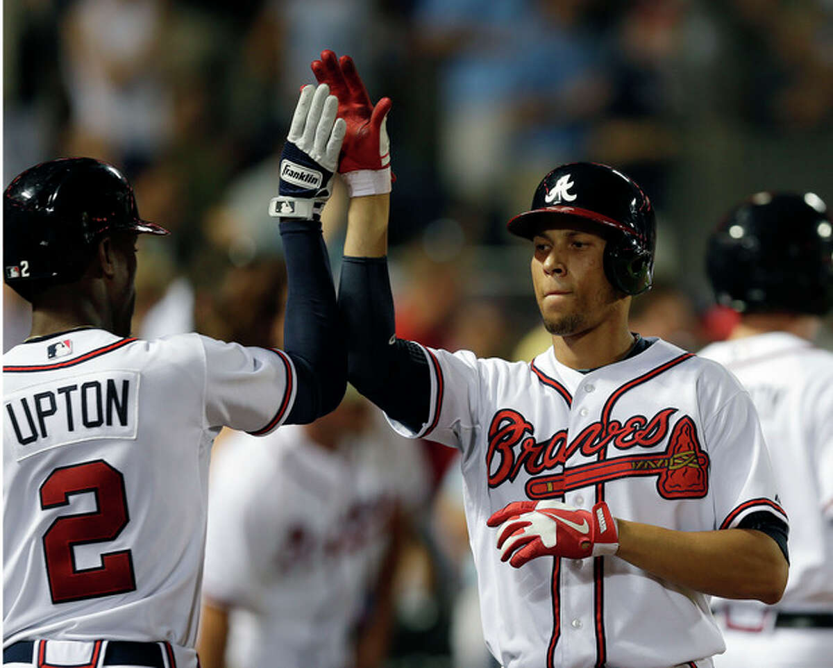 Atlanta Braves' Andrelton Simmons, right, celebrates with B.J. Upton after Simmons hit a two-run home run in the seventh inning of a baseball game against the New York Mets on Tuesday, Sept. 3, 2013, in Atlanta. (AP Photo/John Bazemore)