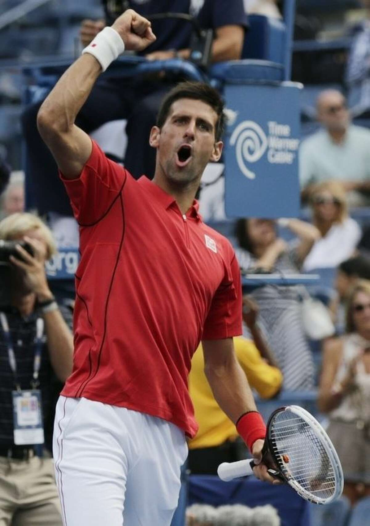 Novak Djokovic, of Serbia, after defeating Marcel Granollers, of Spain, in straight sets during the fourth round of the 2013 U.S. Open tennis tournament, Tuesday, Sept. 3, 2013, in New York. (AP Photo/Charles Krupa)