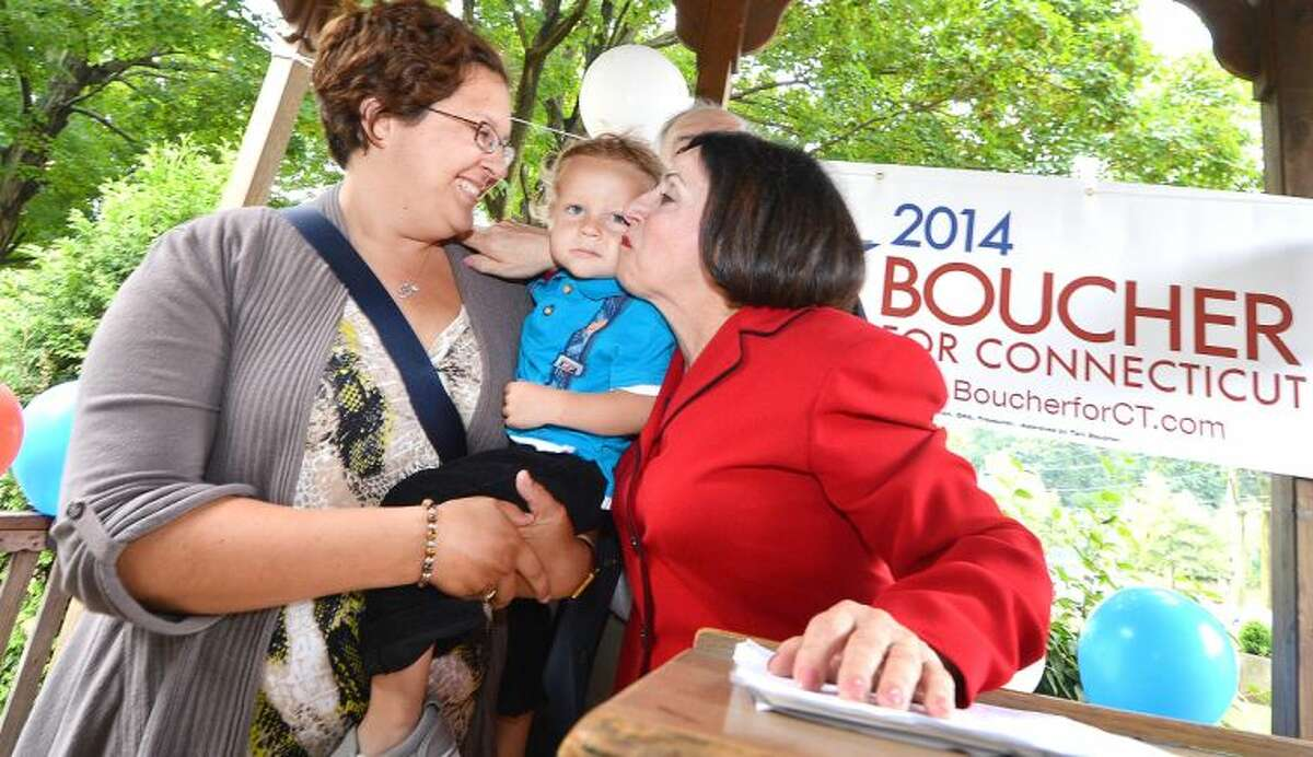 Hour Photo/Alex von Kleydorff . Courtney Boucher holds 20 month old Isaac Boucher as he gets a kiss from his Grandmother State Senator Toni Boucher. Toni Boucher is exploring a run for Governor, announcing her plans from her hometown of Naugatuck on Tuesday morning