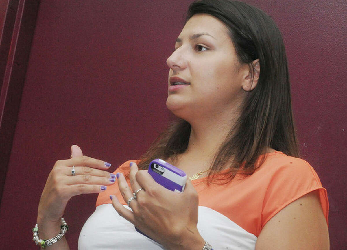 Nathalia Gonzalez asks a question Tuesday night at the Mayoral Debate Forum.