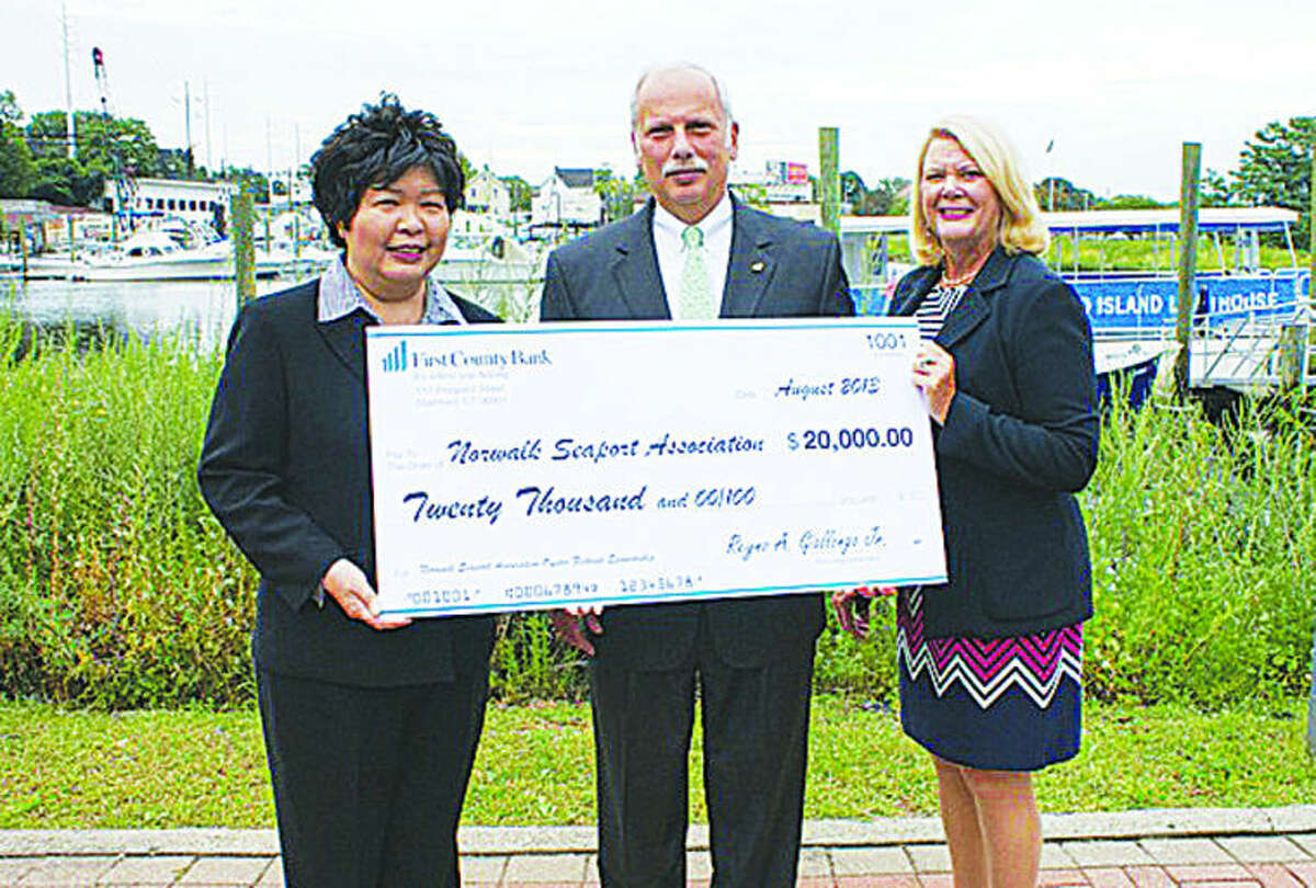 From left to right: Irene Dixon, President Norwalk Seaport Association, Reyno A. Giallongo, Chairman and CEO First County Bank, Katherine Harris, President and COO First County Bank
