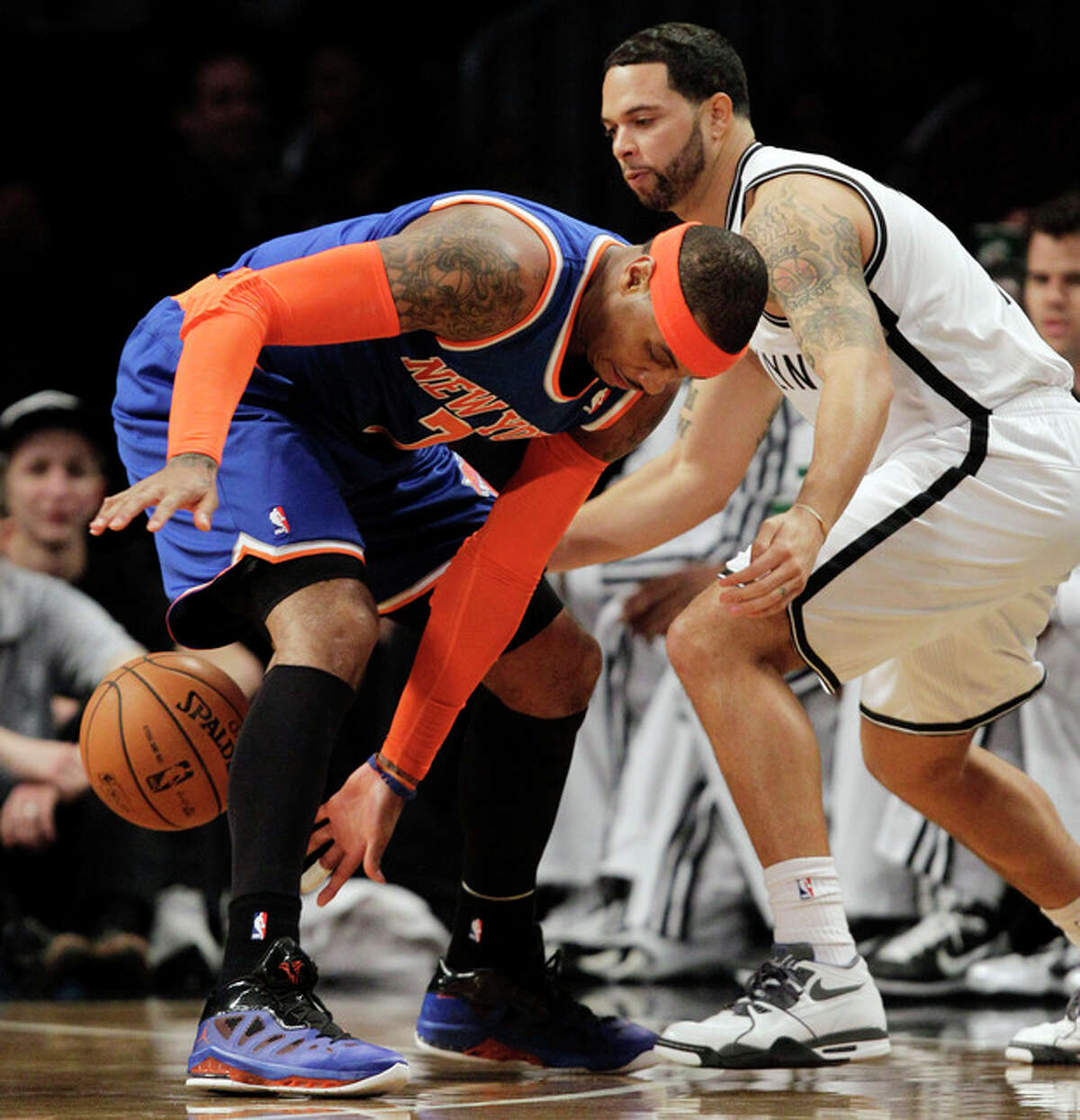 New York Knicks forward Carmelo Anthony (7) loses the ball as Brooklyn Nets guard Deron Williams (8) defends in the first half of their their NBA basketball game at Barclays Center, Tuesday, Dec. 11, 2012, in New York. (AP Photo/Kathy Willens)