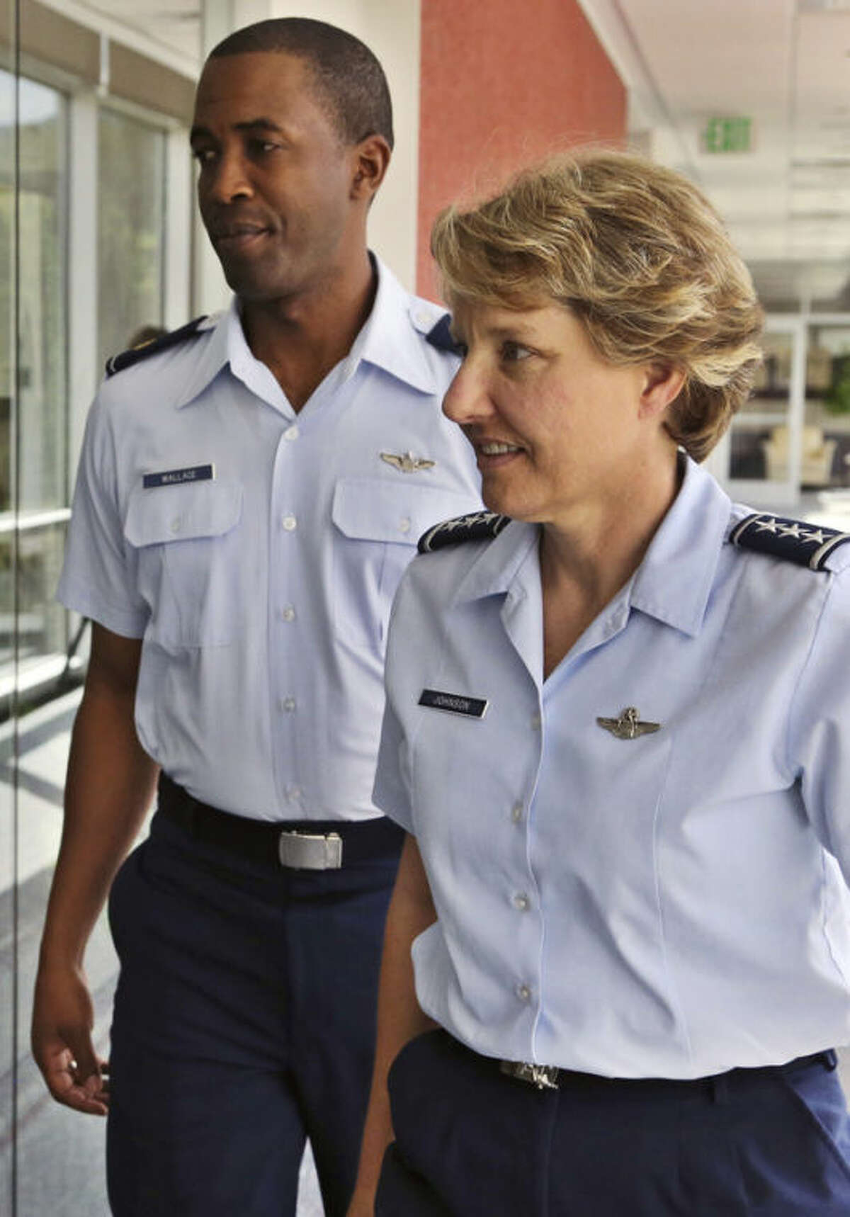 New U.S. Air Force Academy Superintendent Lt. Gen. Michelle Johnson, right, walks with her Executive Officer Major Lonzo Wallace, following an interview with The Associated Press, at Johnson's office at the Air Force Academy, near Colorado Springs, Colo., Tuesday Aug. 27, 2013. Johnson, herself an Air Force Academy graduate who has served as a career Air Force officer and pilot, is the first female superintendent of a major U.S. service academy. (AP Photo/Brennan Linsley)