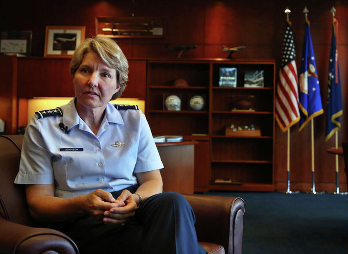 New U.S. Air Force Academy Superintendent Lt. Gen. Michelle Johnson speaks during an interview with The Associated Press, at her office at the Air Force Academy, near Colorado Springs, Colo., Tuesday Aug. 27, 2013. The first woman to lead the Air Force Academy says she faced resistance and harassment in her career, but competence and confidence helped her push through the ranks to one of the top jobs in the service. (AP Photo/Brennan Linsley)