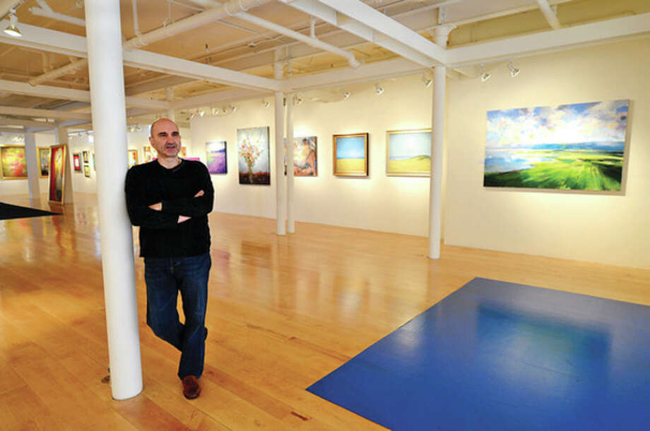 Hour photo / Erik TrautmannClaude Villani, President of Galerie SoNo, moved his gallery several store fronts down to 123 Washington St. / (C)2012, The Hour Newspapers, all rights reserved