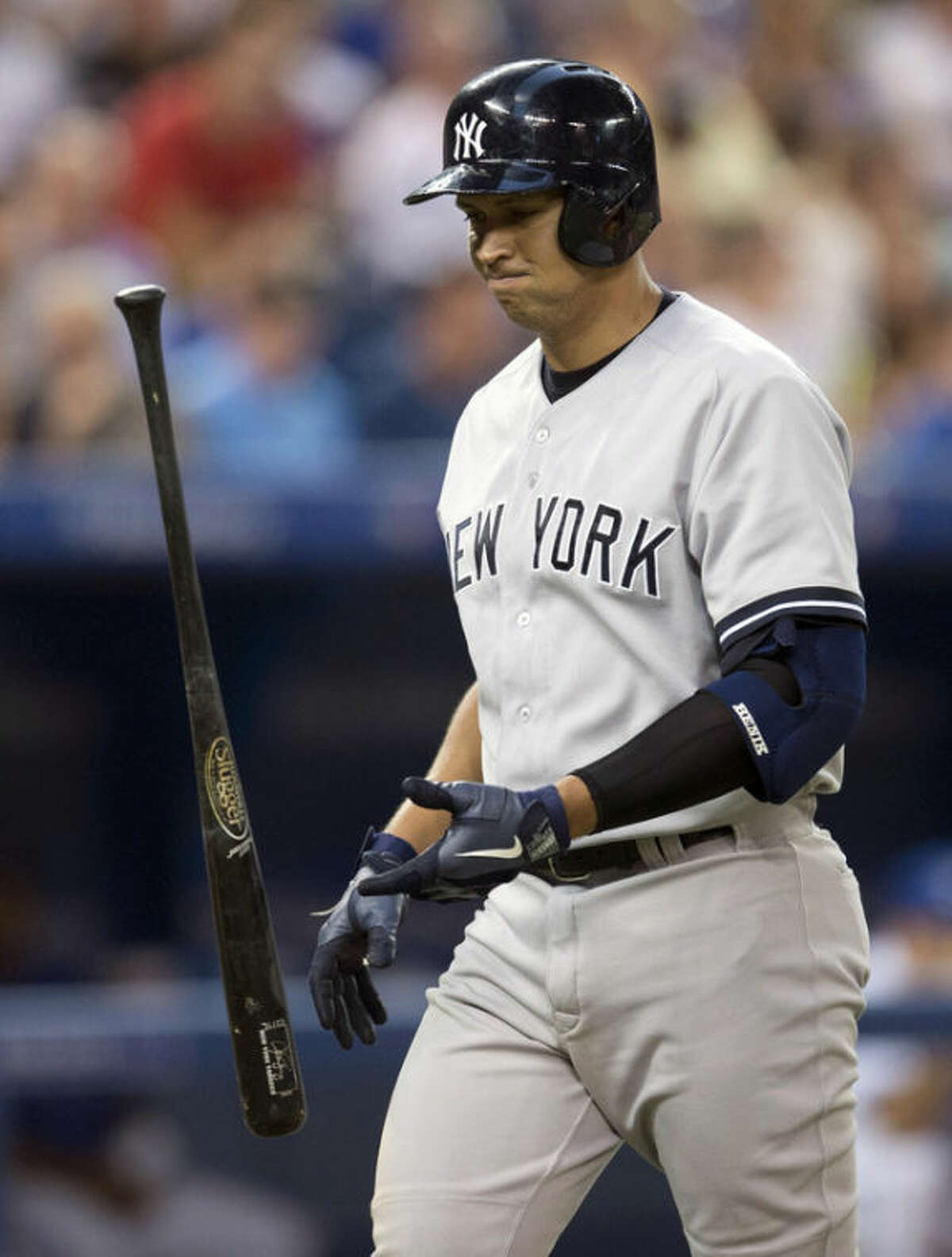 New York Yankees' Alex Rodriguez reacts after striking out against the Toronto Blue Jays during second-inning AL baseball game action in Toronto, Wednesday, Aug. 28, 2013. (AP Photo/The Canadian Press, Frank Gunn)