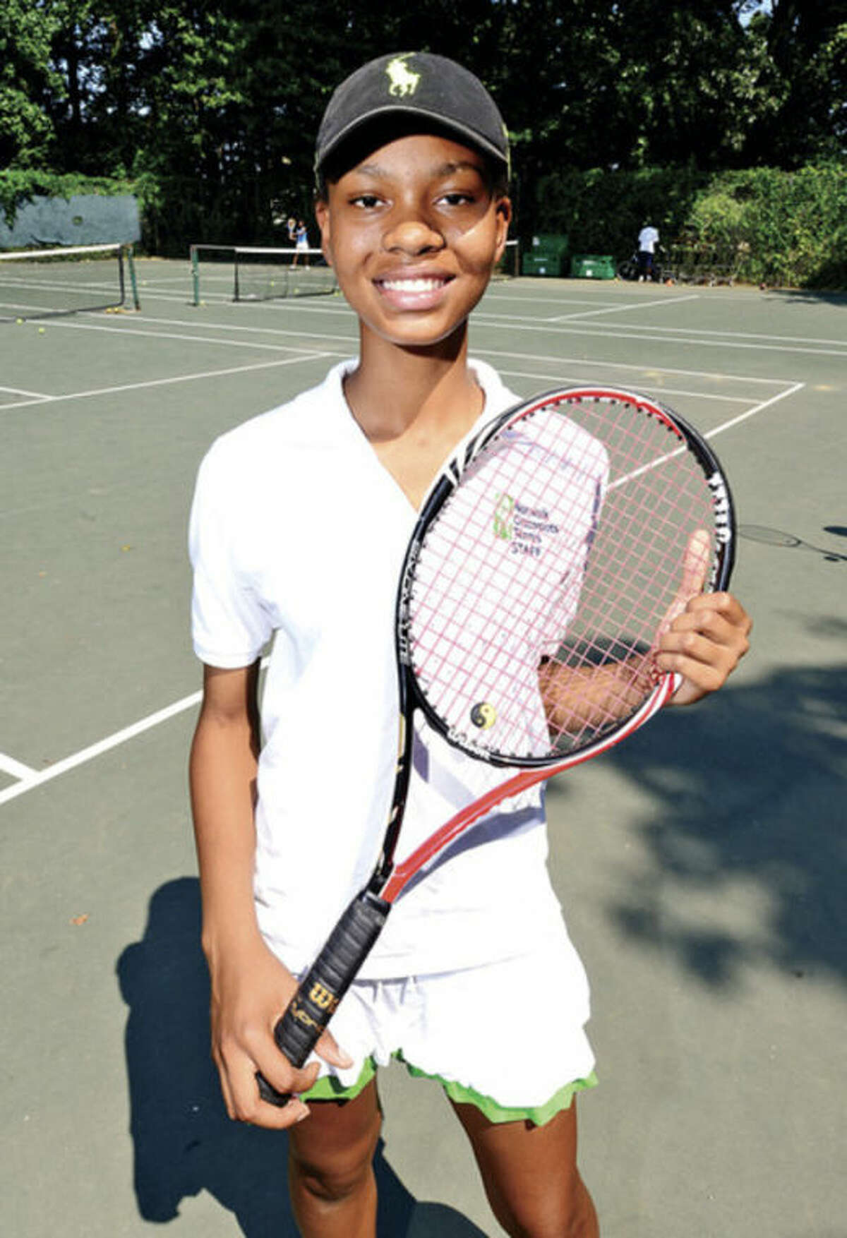 Sehvrine Lezeau has been involved with the Norwalk Grassroots Tennis program for five years and last spring became a varsity starter for the Brien McMahon girls tennis team. Off the court, the local youth program has changed her life even more. @Cutline Byline:Hour photo/ Erik Trautmann