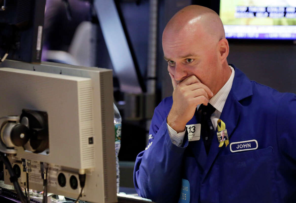 Specialist John O'Hara works at his post on the floor of the New York Stock Exchange, Tuesday, Aug. 27, 2013. Worries about a potential military strike against Syria are dragging down the U.S. stock market in early trading. (AP Photo/Richard Drew)
