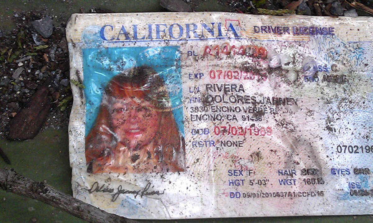 A California driver's license bearing the name of Jenni Rivera driving sits on the ground at the site where a plane allegedly carrying Rivera crashed near Iturbide, Mexico Sunday Dec. 9, 2012. The wreckage of a the small plane believed to be carrying Jenni Rivera, the U.S-born singer whose soulful voice and unfettered discussion of a series of personal travails made her a Mexican-American superstar, was found in northern Mexico on Sunday. Authorities said there were no survivors. (AP Photo)