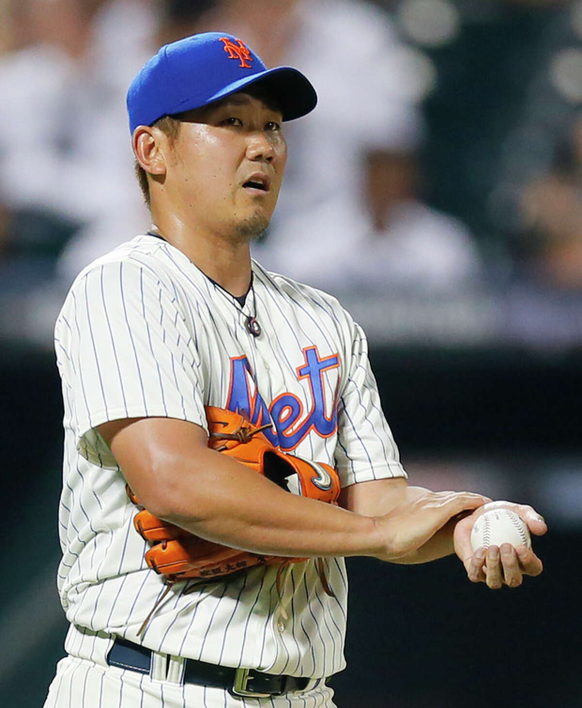 New York Mets starting pitcher Daisuke Matsuzaka (16) reacts after giving up a double to Philadelphia Phillies' Michael Young in the fifth inning of a baseball game at Citi Field in New York, Wednesday, Aug. 28, 2013. (AP Photo/Paul J. Bereswill)