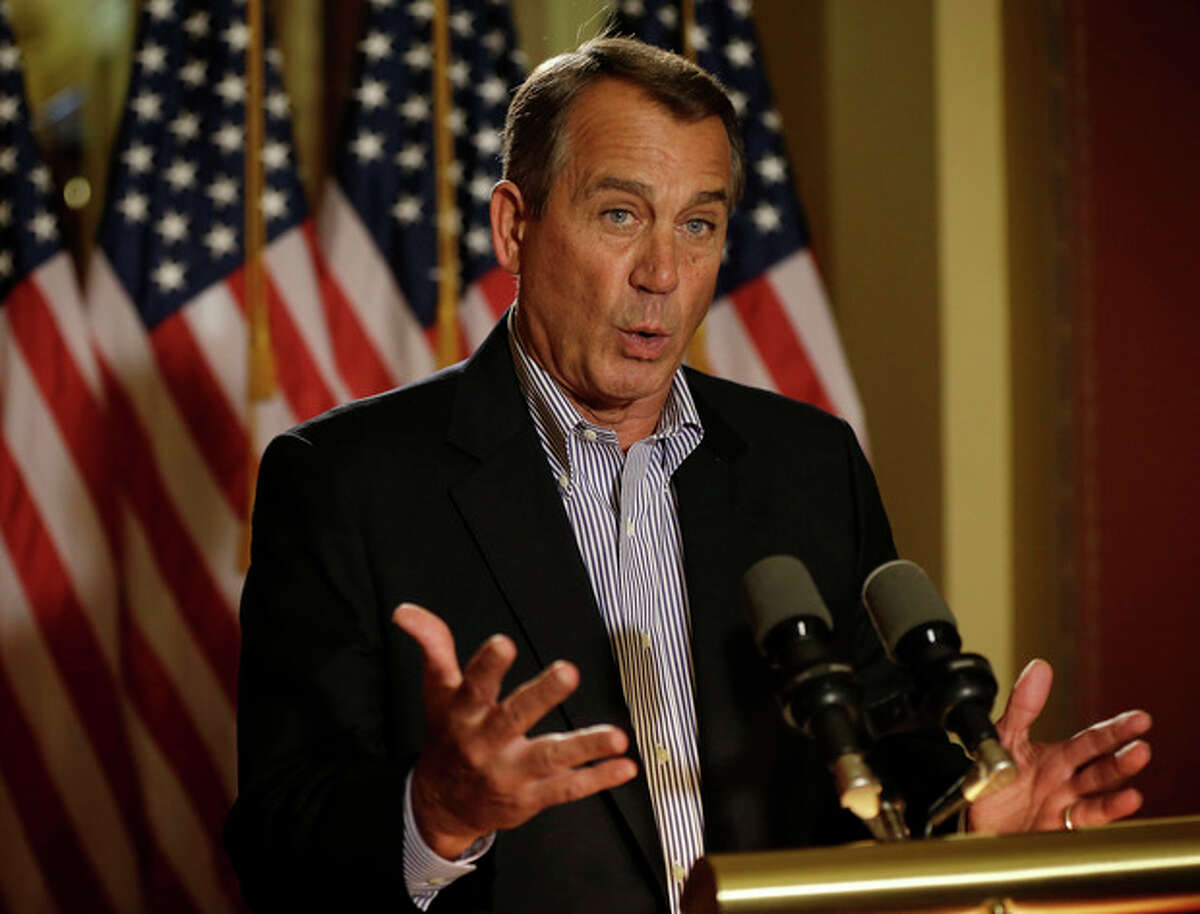 House Speaker John Boehner of Ohio gestures as he speaks during a news conference on Capitol Hill in Washington, Friday, Dec. 7, 2012, to discuss the pending fiscal cliff. Boehner said there's been no progress in negotiations on how to avoid the fiscal cliff of tax hikes and spending cuts and called on President Barack Obama to come up with a new offer. (AP Photo/Pablo Martinez Monsivais)