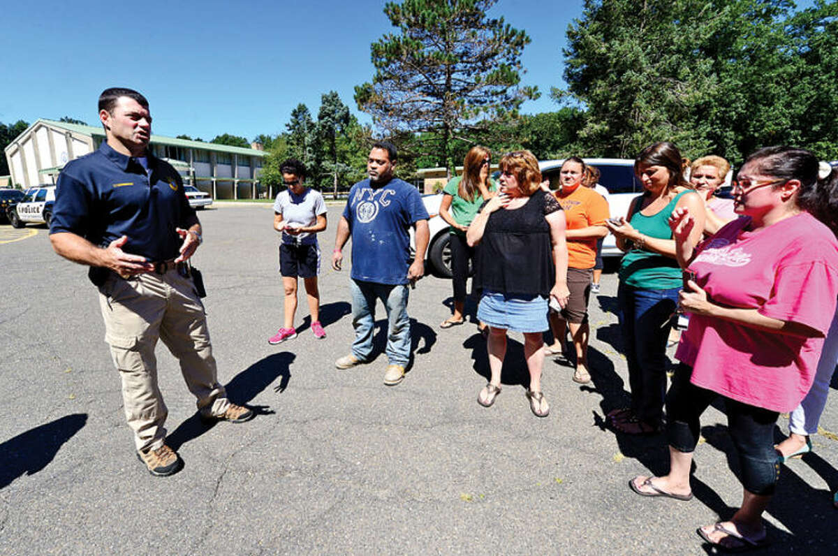 Norwalk Police Lt. Brian Cunningham expalnis that all students are safe after worried parents came to Cranbury Elementary School after a teacher reported hearing gunfire and the school was put on lockdown. Hour photo / Erik Trautmann