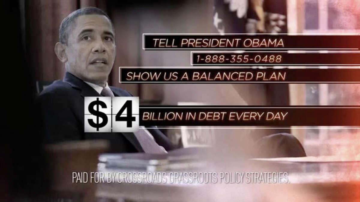 This still image from video released by Crossroads Grassroots Policy Strategies shows a frame from their ad on the
